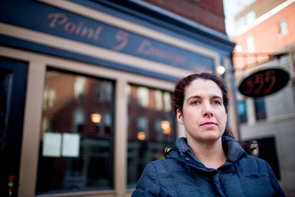 Heather McIntosh of Portland, in front of her former employer, Five Fifty-Five on Congress Street, said in a letter to the editor that she and her co-workers disagree with the restaurant's owners and favor an increase in the minimum wage, including for servers.  Gabe Souza/Staff Photographer