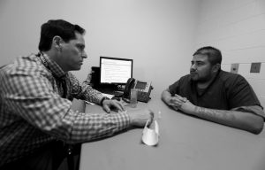 DR. JOSH BLUM, left, confers with inmate Lee Gonzales at the Denver County Jail in downtown Denver in this March 1 photo. Jails and correction agencies across the country such as Denver are teaching soon-to-be-released inmates how to use the heroin overdose antidote called naloxone, either to save others and sometimes themselves.
