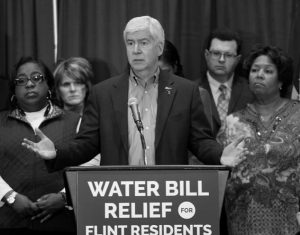 GOV. RICK SNYDER speaks after attending a Flint Water Interagency Coordinating Committee meeting in Flint, Michigan. On March 10, Gov. Snyder released another 4,400 pages of his executive office's emails and documents related to the lead-contaminated water in Flint.