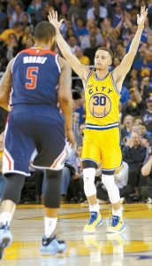 GOLDEN STATE WARRIORS' Stephen Curry (30) celebrates after making a 3-point basket against the Washington Wizards during the second half of an NBA basketball game on Tuesday in Oakland, Calif. Golden State won, 102-94.