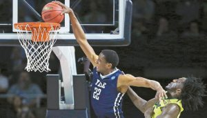 YALE FORWARD JUSTIN SEARS (22) slams a dunk as he gets past Baylor forward Taurean Prince (21) in the second half during the first round of the NCAA college men's basketball tournament in Providence, R.I., on Thursday.