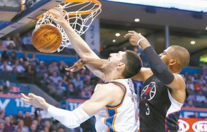 LOS ANGELES CLIPPERS guard Chris Paul (3) knocks the ball away from Oklahoma City Thunder center Enes Kanter, left, during the third quarter of an NBA basketball game in Oklahoma City, on Wednesday. Oklahoma City won 120-108.