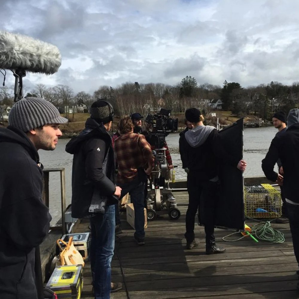 """Crew members prepare for filming on the independent horror movie """"Island Zero"""" on the pier in Rockport last week. The screenplay was written by best-selling Camden author Tess Gerritsen and is directed by her son, Josh Gerritsen."""