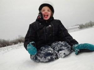 "Cyndimae Meehan slides in the snow shortly after moving to Maine. Her epilepsy left her ""a shell of a child"" before cannabis treatment allowed her to run, laugh and swim."