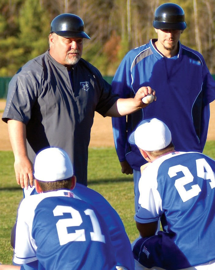 New Old Orchard Beach baseball coach Tom LaChance talks to his team after a scrimmage on Thursday.