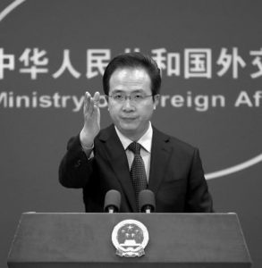 CHINA'S FOREIGN MINISTRY spokesman Hong Lei gestures during a daily briefing at the Ministry of Foreign Affairs office in Beijing today.