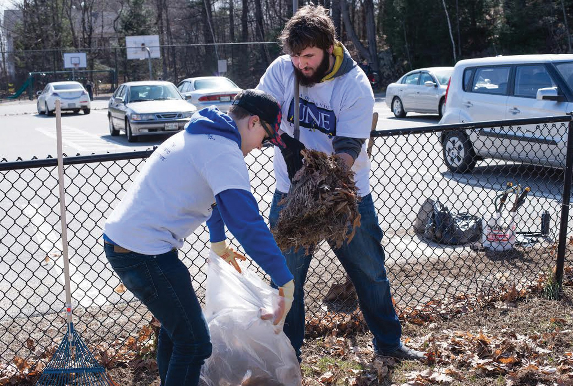 University of New England students clean up trash at Clifford Park in Biddeford on Saturday as part of the University of New England's first Day of Service.