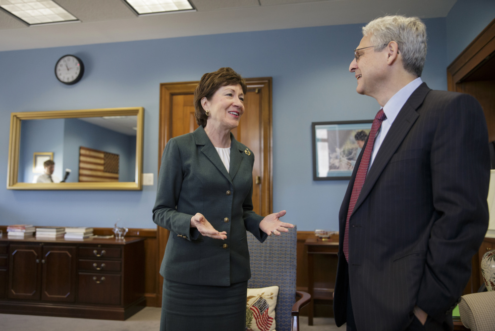 Sen. Susan Collins meets with Judge Merrick Garland, President Obama's choice to replace the late Justice Antonin Scalia on the Supreme Court, Tuesday on Capitol Hill. Collins is one of only two Senate Republicans who say Garland should get a confirmation hearing, against the wishes of Majority Leader Mitch McConnell.