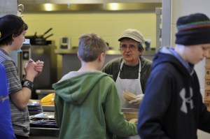Jonathan Erskine, the cafeteria chef, serves students lunch at the Islesboro Central.