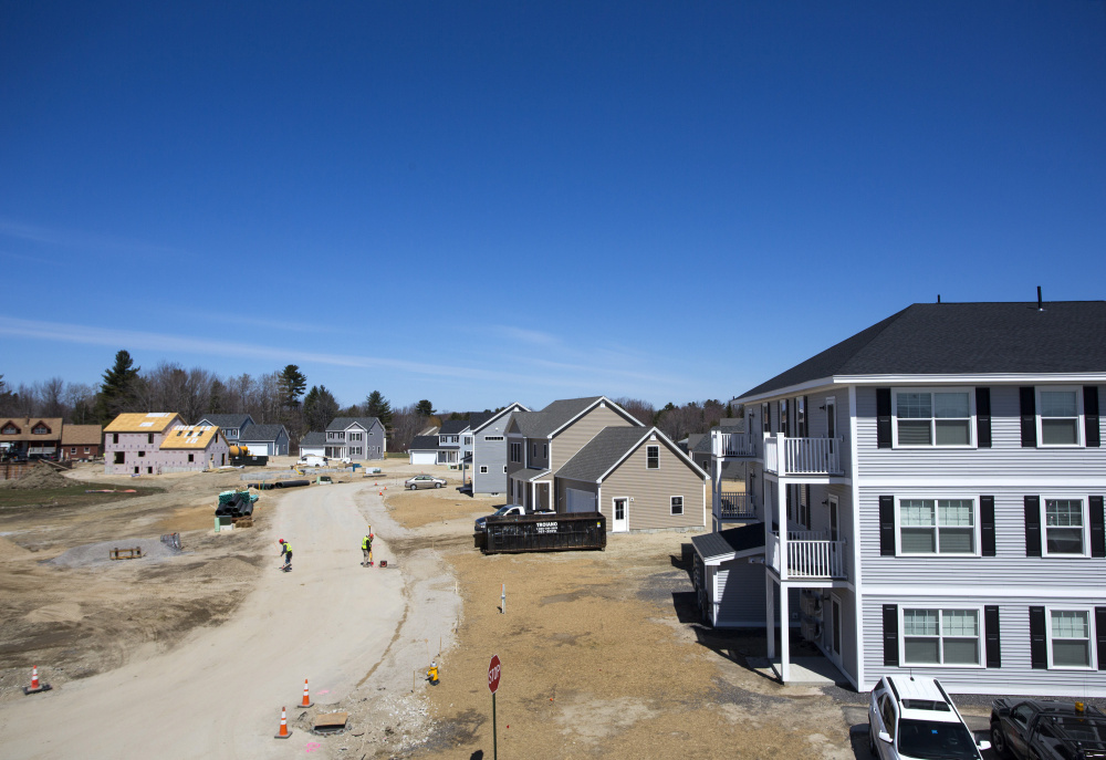 Homes and apartments are under construction at the 183-unit Blue Spruce Farm, the second biggest subdivision in Westbrook's history. Last spring, the developer expected to build out the site in three to five years; less than a year later, all but six of the 53 single-family house lots and most of the apartments have been spoken for.