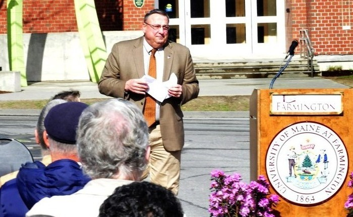 Gov. Paul LePage steps away from the lectern Tuesday while speaking during the dedication of the Theodora J. Kalikow Education Center at the University of Maine in Farmington after students held up signs criticizing him.