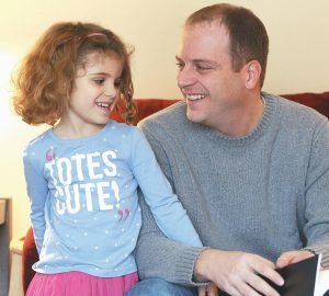 JEFF MCMANAMY shares a moment with his 4-year-old daughter, Brianna, as he talks about his wife, Heather, who passed away last December after a long battle with breast cancer.
