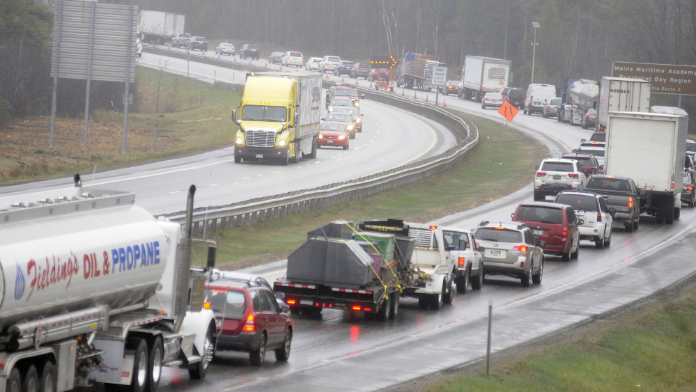 Both northbound lanes of the Maine Turnpike reopened at 11:15 a.m. Monday in Farmingdale following a tractor-trailer accident that delayed traffic for 10 hours.