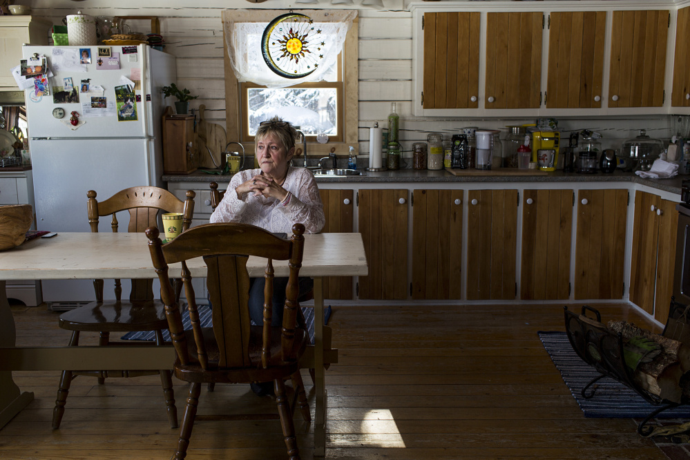 """Hope Kelly sits in the kitchen where she spent at least two hours as more than a half-dozen Maine game wardens searched her home during a 2014 sting operation. The wardens removed 110 jars of her home-canned fruits and vegetables and 36 jars of moose meat. The meat was never proven to be illegally obtained, but it didn't matter: All Kelly ever got back was 33 pints of the garden goods. """"I'm assuming they ate"""" the rest, she says."""