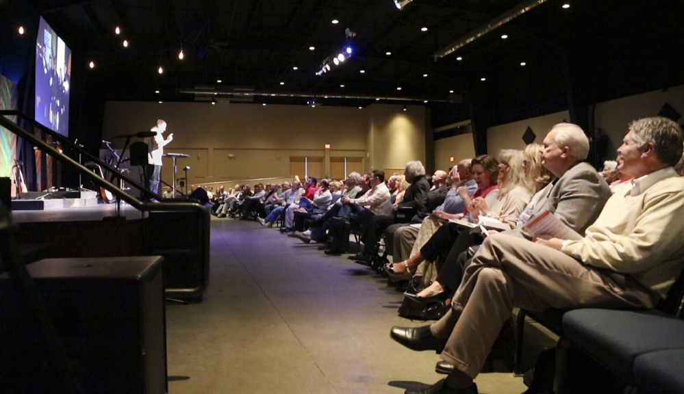 """Outreach Pastor Kurt Holmgren leads a sermon at a recent Eastpoint Christian Church service. """"We believe you should love everybody,"""" Holmgren said, """"no matter what they believe."""""""