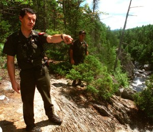 Warden Roger Guay points out a dangerous area along the hiking trail at Gulf Hagas to fellow Warden Pat Dorian in 1995. Guay, who retired after 25 years with the Maine Warden Service, has been involved in more searches for missing people than he can count. He said hikers have to be prepared, to stay alive and to help searchers find them.