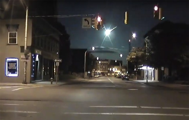 This dashcam image from a police car in Pittsburgh, Pa., shows a meteor entering earth's atmosphere that a police officer in Portland witnessed at the same moment early Tuesday morning. Courtesy American Meteor Society