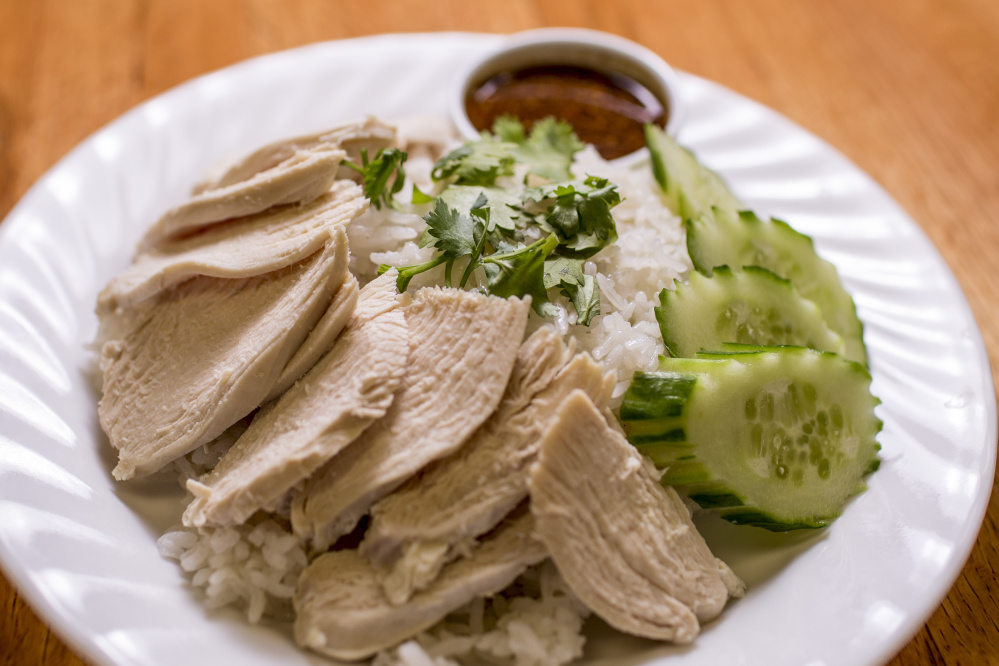 Khao mun gai is steamed chicken over seasoned rice with homemade sauce at Thai Esaan. Gabe Souza/Staff Photographer