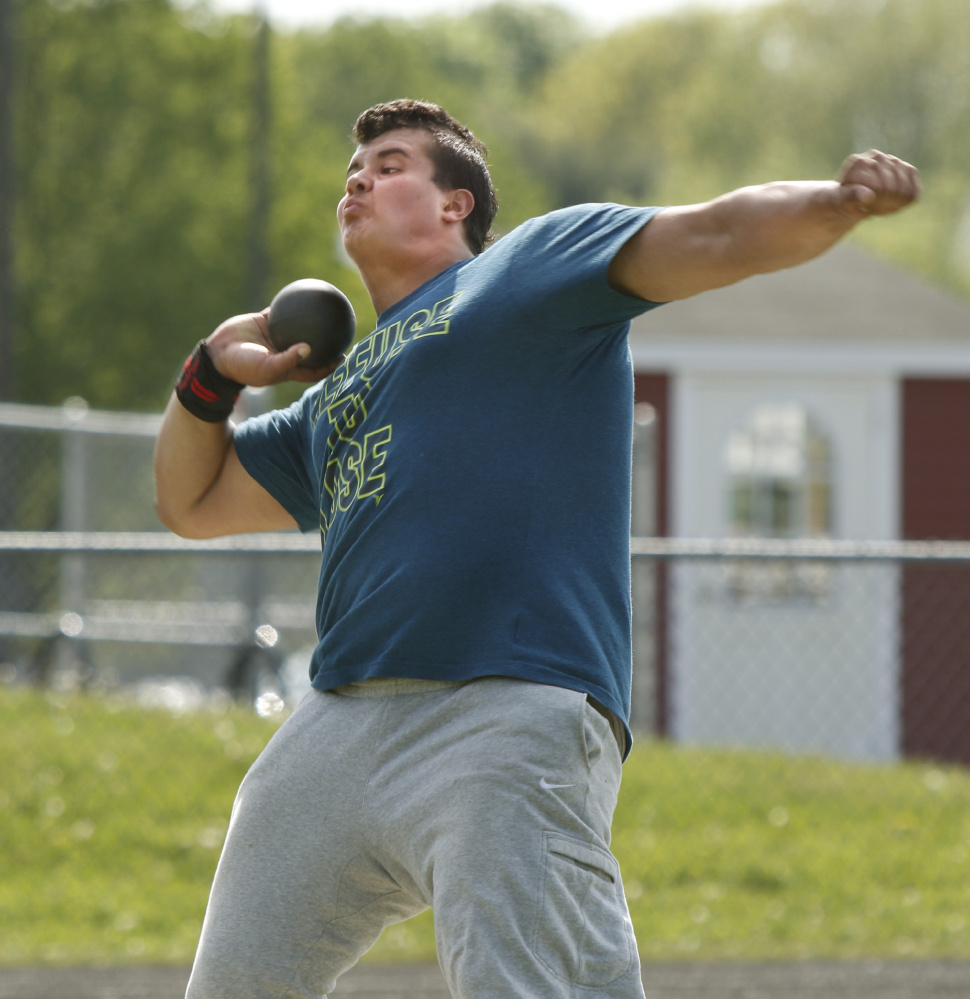 Shot putter Dan Guiliani practices for the event at South Portland High School.