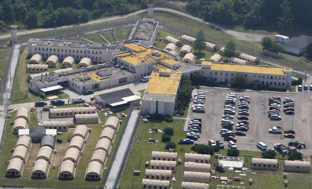 The Louisiana State Penitentiary at Angola is seen in West Feliciana Parish, La. U.S. District Judge Brian Jackson asked why officials won't spend $1 million to install air conditioning.