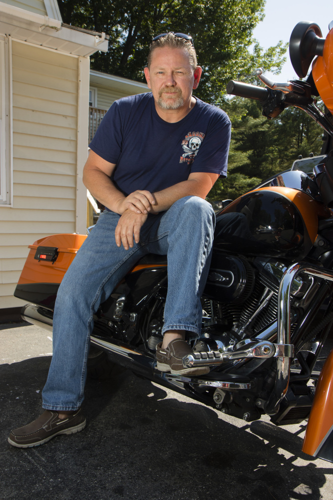 """Chuck Phillips, 49 sits on his motorcycle outside his house in Saco on Friday. He says he'll vote for Trump, but also has issues with the Republican. """"I'm not overly crazy about him but I find him the more palatable candidate."""""""