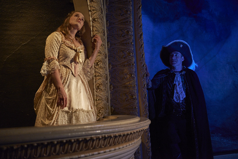 Christopher Holt as Cyrano watches his love interest, played by Marjolaine Whittlesey.
