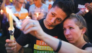 JENNIFER, RIGHT, and Mary Ware light candles during a vigil in Orlando, Florida, for the victims of the mass shooting at the Pulse nightclub. On Sunday, June 12, 2016, a gunman killed dozens at the crowded gay nightclub, making it the deadliest mass shooting in modern U.S. history.