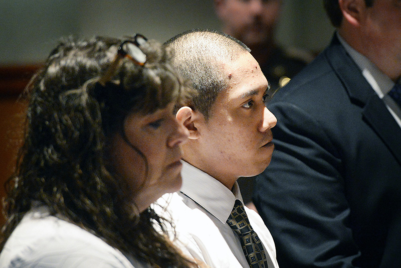 Johnny Ouch appears in the Cumberland County Courthouse in Portland with defense attorney Amy Fairfield to change his plea to guilty on Thursday.