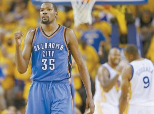 OKLAHOMA CITY THUNDER forward Kevin Durant (35) reacts during the second half of Game 7 of the NBA basketball Western Conference finals against the Golden State Warriors in Oakland, Calif. Durant announced Monday that he is joining All-Stars Stephen Curry and Klay Thompson with the Golden State Warriors. He can't officially sign until July 7.