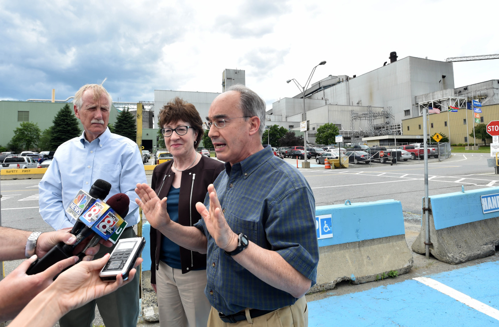From left, Sen. Angus King, Sen. Susan Collins and Rep. Bruce Poliquin speak Friday after a tour of Sappi Fine Paper in Skowhegan. They were at the paper mill to highlight creation of a federal team that will look at the future of the forest products industry.