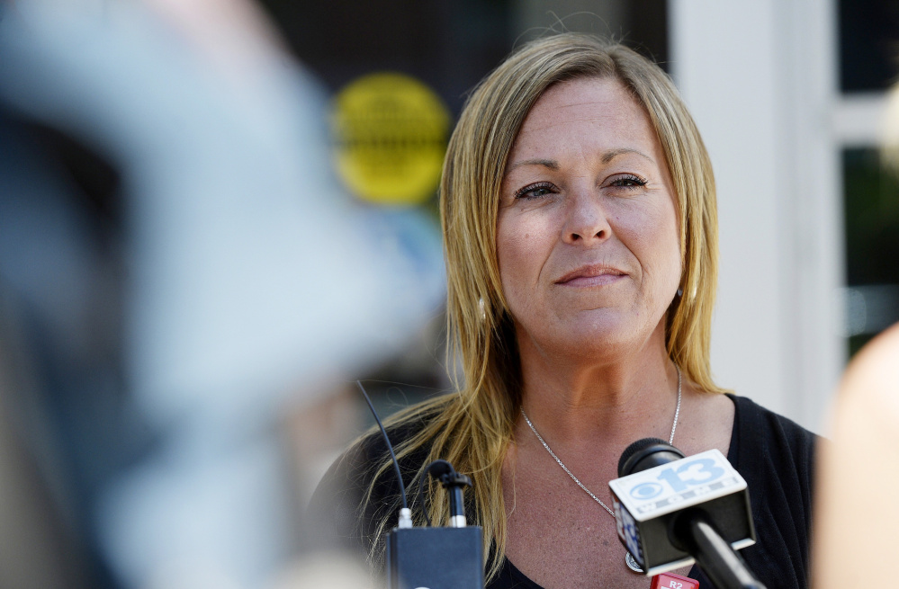 Nancy Laxson, the mother of shooting victim Treyjon Arsenault, speaks to reporters after Johnny Ouch's court appearance Thursday. The trial for Gang Deng Majok, the man accused of shooting her son, is scheduled to begin Sept. 12.