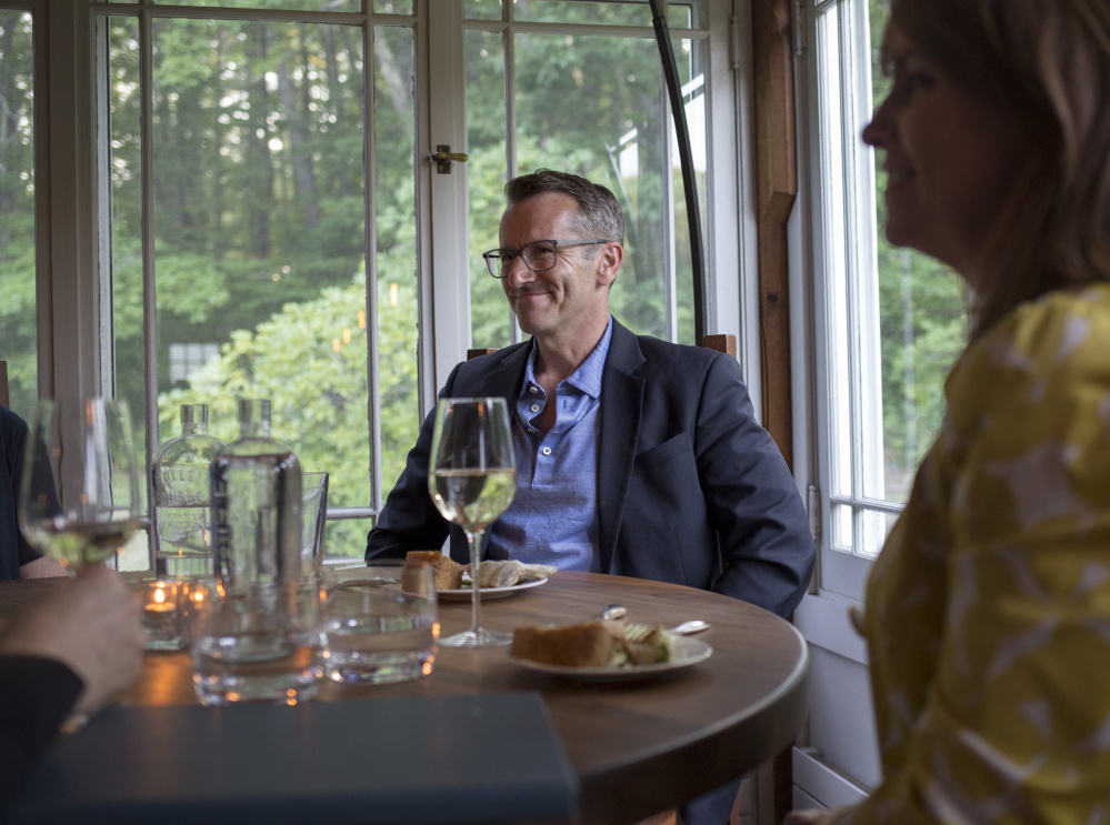 Above: Jeff Bell enjoys a dinner with friends at The Velveteen Habit in Cape Neddick. The restaurant in an old farmhouse has four acres of gardens out back. Left: A beet salad with strawberries, ricotta and olives.