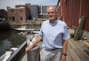"Charlie Poole, president of Proprietors of Union Wharf, says that ""without ... proper water depth at all tides, we do not have anything to offer the marine business world."" At left, the channel in the central part of the harbor is dredged in 2014."