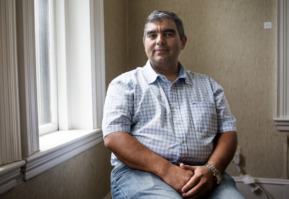 PORTLAND, ME - AUGUST 16: Tarlan Ahmadov, program director for refugee and immigration services at Catholic Charities, poses for a portrait at the organization's office. (Photo by Brianna Soukup/Staff Photographer)