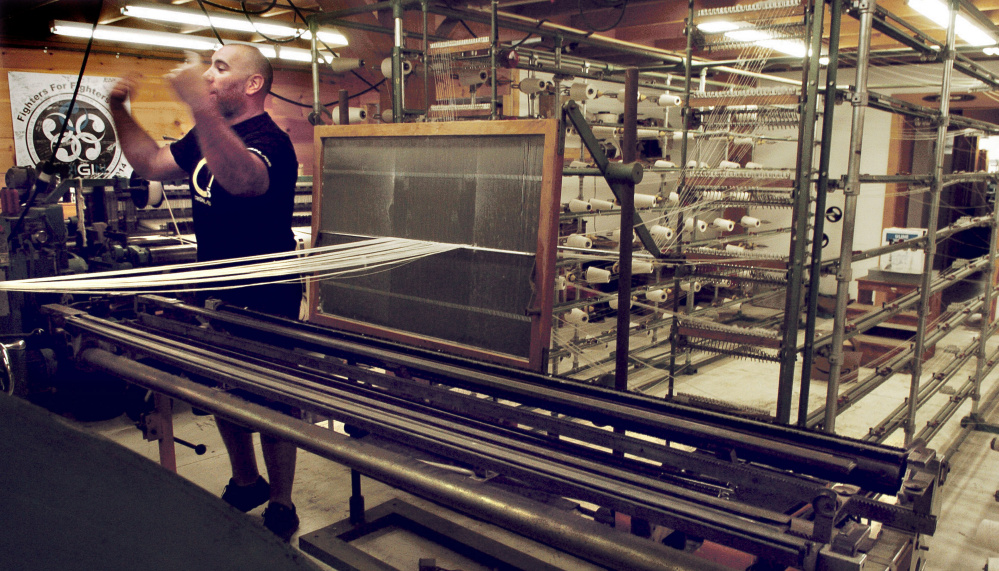 OriginUSA owner Peter Roberts speaks about purchasing unused equipment like this loom that is used to manufacture martial arts garments in Industry.
