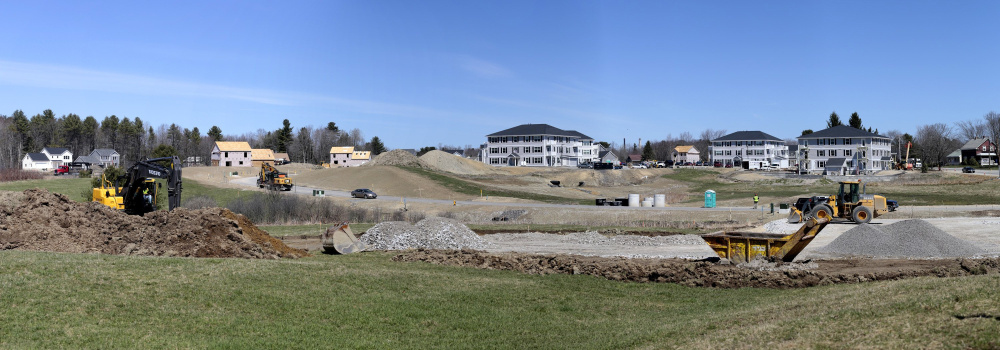 Blue Spruce Farm, seen under construction in April, could bring a total of about 500 housing units to Westbrook. Residents worry about the impact on city schools.