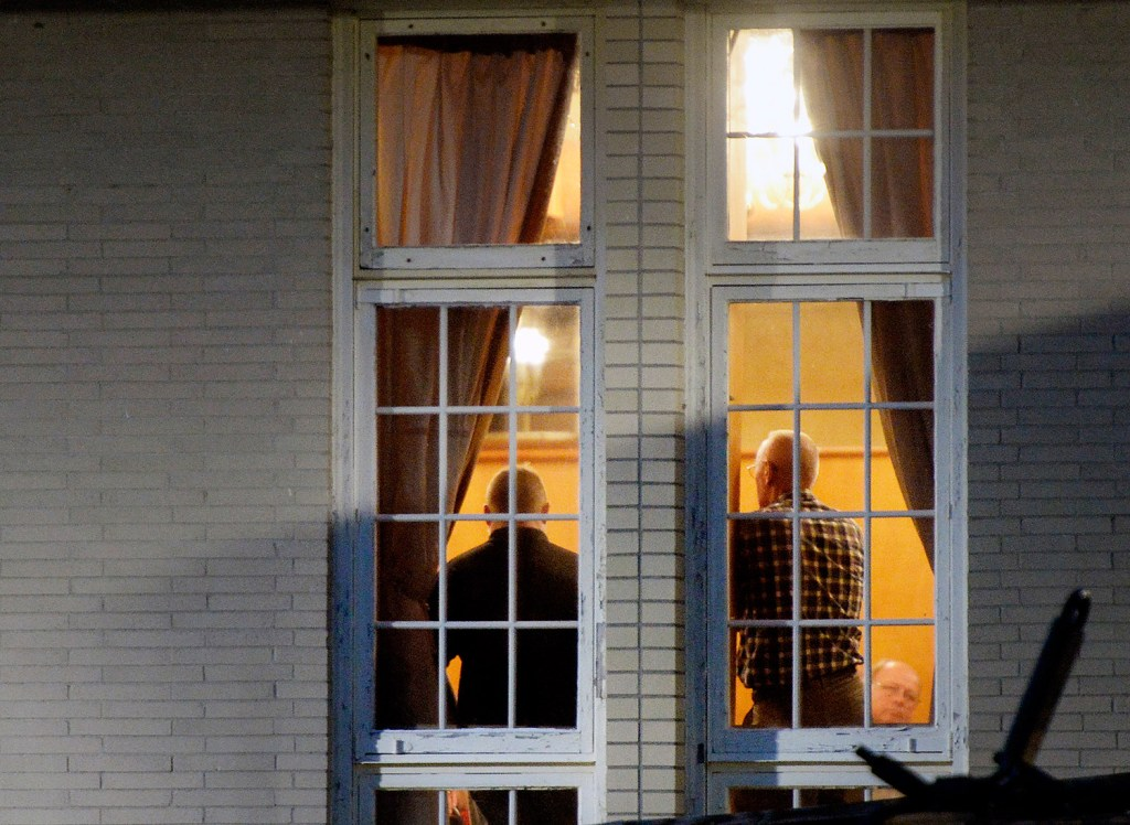 Maine House Republicans confer inside the Governor Hill Mansion on Tuesday night during a closed-door meeting on Gov. Paul LePage's racially charged comments and threat against a Democratic lawmaker. After the meeting, House Minority Leader Ken Fredette said it would be up to LePage to decide whether he wants to apologize to people of color. Shawn Patrick Ouellette/Staff Photographer