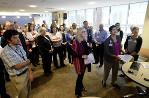 Staff at Maine Medical Center attend a morning meeting to discuss the number of beds versus the number patients coming in. The hospital plans an expansion that will add 64 inpatient beds.