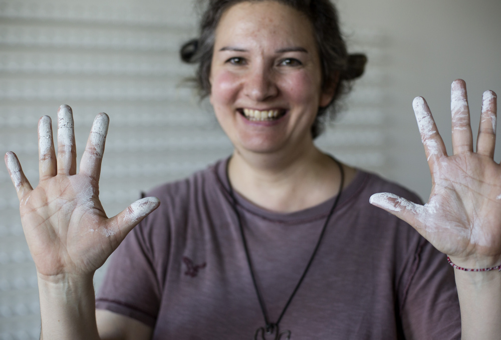 LEWISTON, ME - SEPTEMBER 9: Amy Stacey Curtis installs Memory, the 9th of 9 solo-biennial exhibits of interactive installation. Curtis has been doing a lot of painting things white for her final installation of the 18 year project. (Photo by Derek Davis/Staff Photographer)