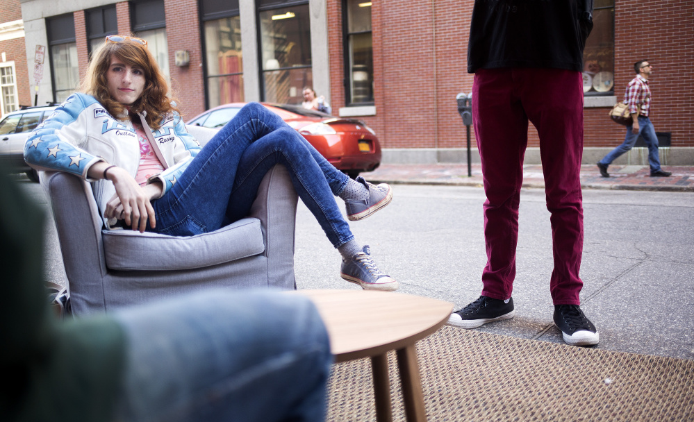"PORTLAND, ME - SEPTEMBER 16: Rose Bloem, a sophomore at MECA, relaxes in a parking spot ""living room"". The parking spot was transformed by Think Tank Coworking for PARK(ing) Day 2016. Parking spots were temporarily reclaimed and converted into public space. The day, which is celebrated all over the world, is meant to challenge people to rethink the use of our streets as public space. (Photo by Brianna Soukup/Staff Photographer)"