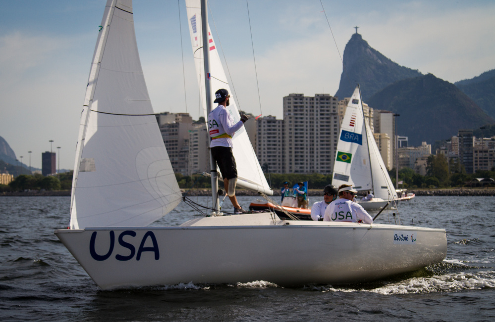 """Hugh Freund, left, looks back toward Rio de Janeiro, as he and crewmates Rick Doerr and Brad Kendell sail their keelboat. """"Sailing's a huge mental game,"""" he said, noting """"We were in a tricky spot."""" Will Ricketson/US Sailing"""
