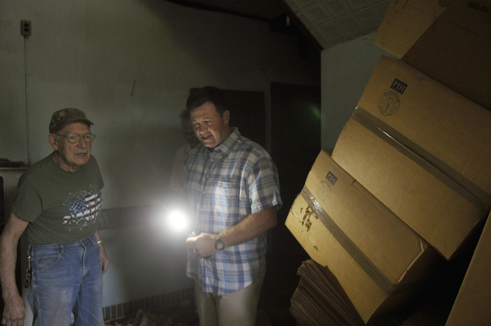 Matt Morrill, right, guides Hallowell resident Burt Truman through a building at the Stevens School Complex in Hallowell during a June 27 tour of the property.