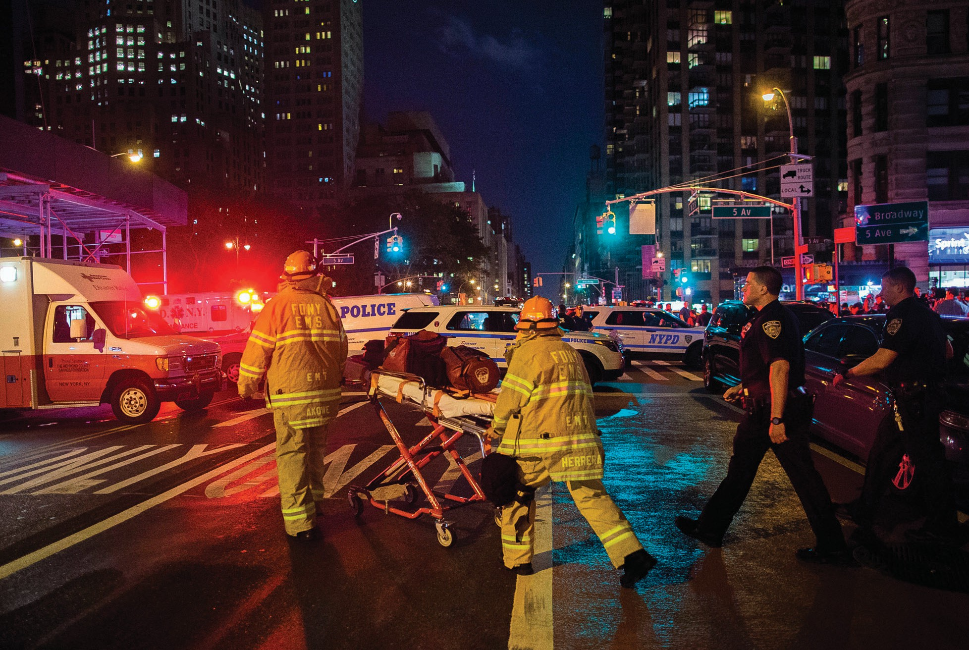 In this Sept. 17 file photo, first responders work near the scene of an explosion in Manhattan's Chelsea neighborhood in New York. On Friday, a New Jersey Muslim religious leader spoke against violence like the New York bombings.