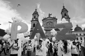 "PEOPLE HOLD UP LETTERS that form the word ""Peace"" in Spanish during a gathering at Bolivar square in Bogota, Colombia, Monday. Colombia's government and the Revolutionary Armed Forces of Colombia signed a peace agreement to end over 50 years of conflict, in Cartagena."