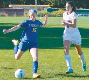 FREEPORT HIGH SCHOOL soccer player Taylor Dostie closes in on Falmouth's Grace Connolly (15) as she sends a ball up the field during Thursday's Western Maine Conference game in Freeport. The Falcons fell 5-0 after Falmouth scored a goal just 14 seconds into the match.