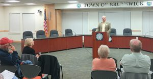 JOHN BRAUTIGAM discusses upcoming ballot questions Thursday at a meeting hosted by the League of Women Voters of Maine's Brunswick chapter.
