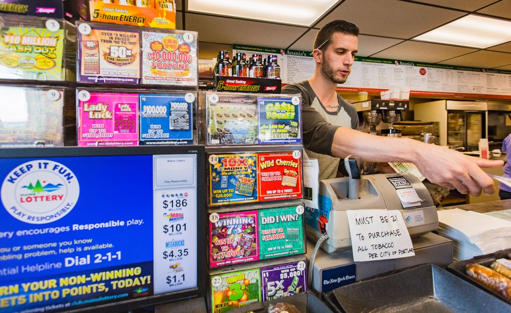 Brett Robertshaw sells a scratch lottery ticket at Anania's in Portland on Sunday. The Maine Lottery had the biggest success in its 42-year history during the 2016 fiscal year, hitting record highs for ticket sales, prizes paid to winners, commissions earned by retailers and contributions to Maine's General Fund. A total of $57 million in lottery proceeds went into the fund, up from $54 million in fiscal year 2015.