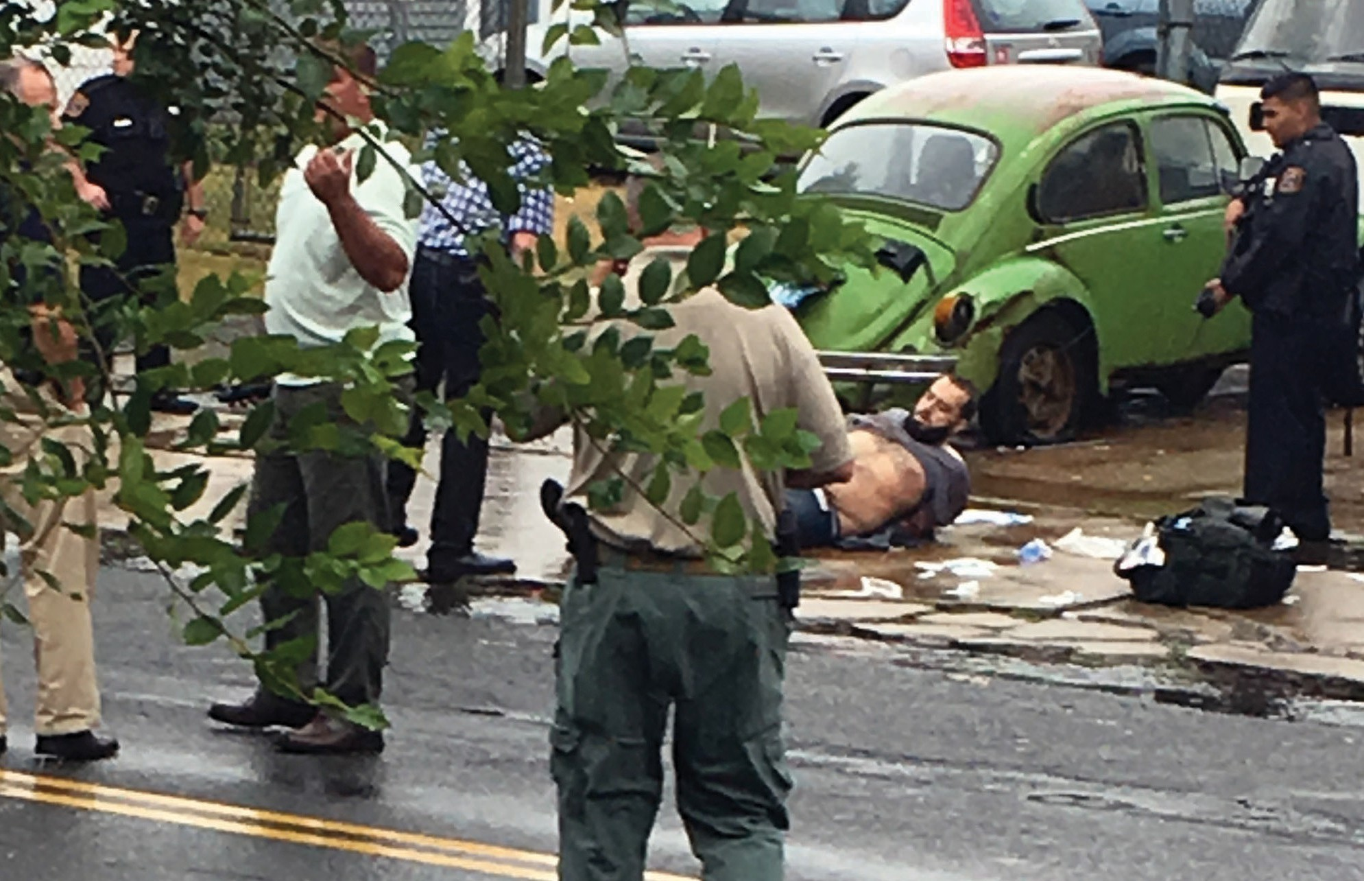 Ahmad Khan Rahami is taken into custody after a shootout with police Monday in Linden, N.J. Rahami was wanted for questioning in the bombings that rocked the Chelsea neighborhood of New York and the New Jersey shore town of Seaside Park.