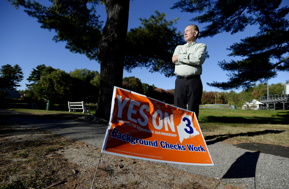 "Bradley Ronco of Portland, who says many of the ""Yes on 3"" signs in his neighborhood have been knocked down or stolen, stands Wednesday near one of the remaining signs, on Ludlow Street."