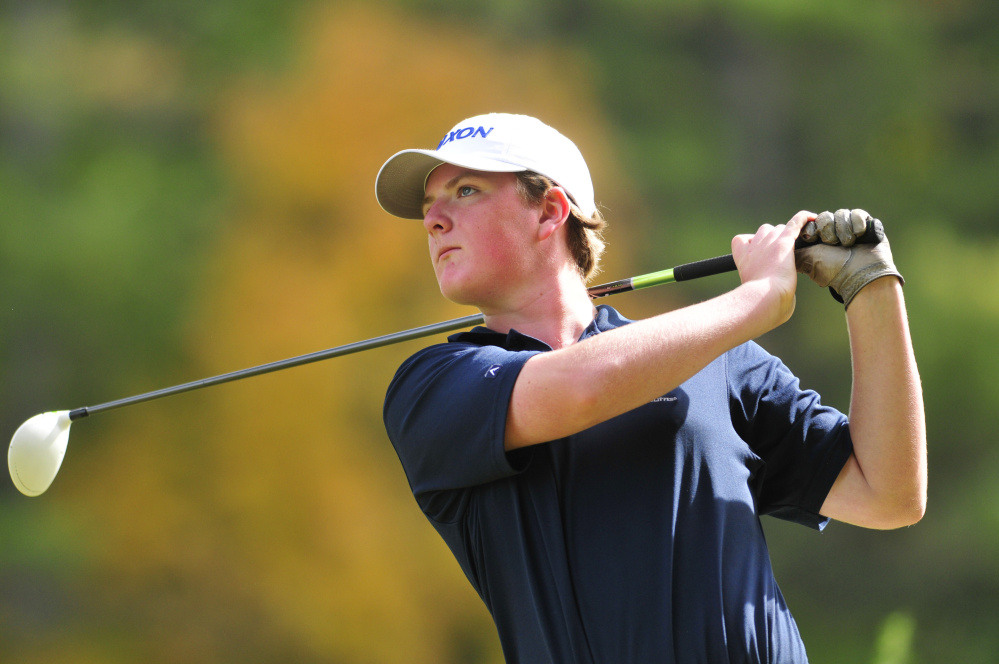 Joe Phelan/Kennebec Journal Yarmouth golfer Mac Leahy tees off on 17th hole during state team golf championship on Saturday at Natanis Golf Course in Vassalboro.